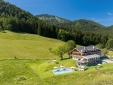 """chiemsee chalet balcony with private hot tube """"Bergwiesen-Chalet-Suite"""""""