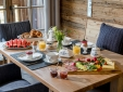 Outdoor Infinity-Pool with view to lake Chiemsee, open from end of april to end of october.