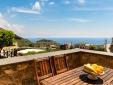 Living room, kitchen and bathroom in La Rotonda apartment